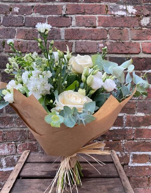 White Bouquet in brown paper